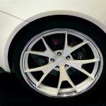 Urolube replacing brakes and tires on Aston Martin